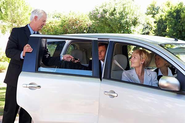 man getting in carpooling car
